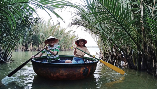 Couple is paddling basket boat by themselves